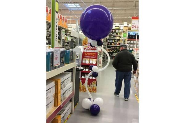 Colonne en ballons à ressort : violette et blanche