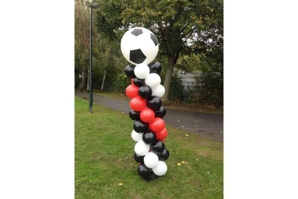 Colonne foot en ballon : sur l'herbe