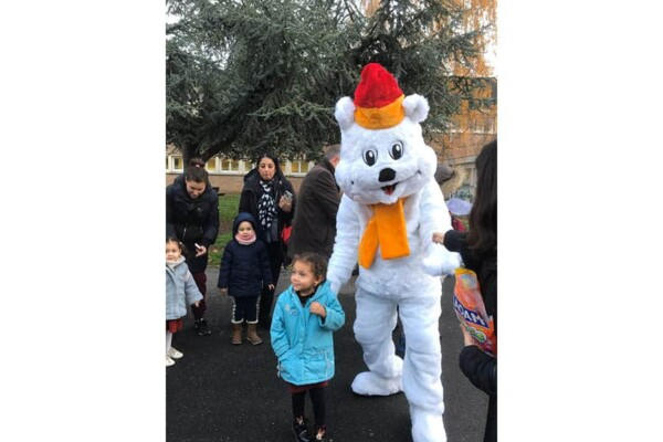 Mascotte Ours blanc de Noël : photo star