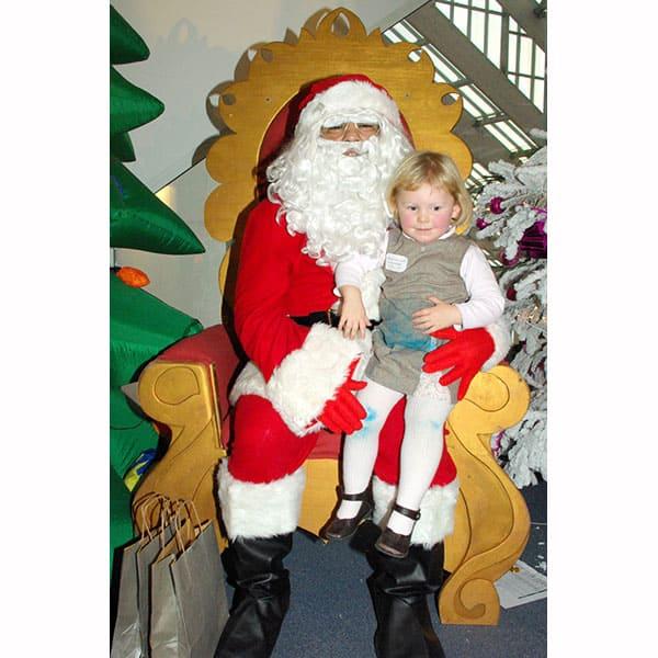 Trône du Père Noël : avec une enfant